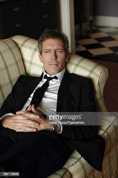107663006 Actor Hugh Laurie is photographed for Madame Figaro on October 3 2013 in London England Suit and shirt tie personal watch CREDIT MUST READ...