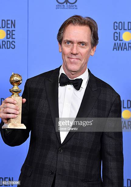Actor Hugh Laurie poses in the press room during the 74th Annual Golden Globe Awards at The Beverly Hilton Hotel on January 8 2017 in Beverly Hills...