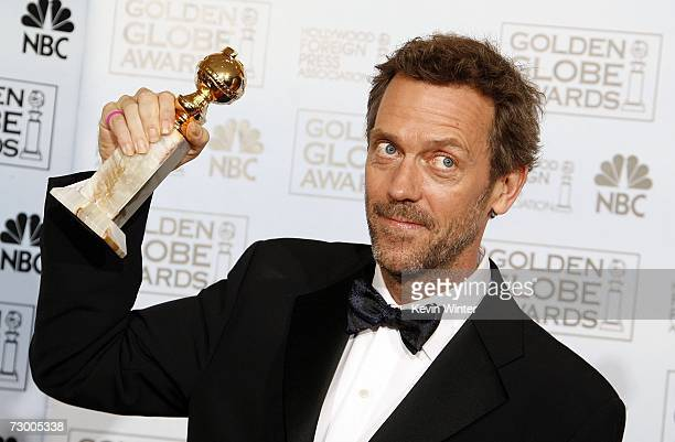 Actor Hugh Laurie poses with his award for Best Performance by an Actor in a Television Series Drama for House MD backstage during the 64th Annual...