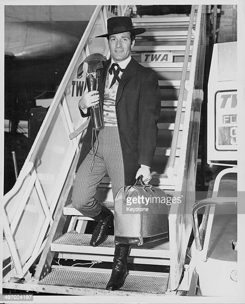 Actor Hugh O'Brian wearing his 'Wyatt Earp' costume arriving at Idlewild Airport in New York for the Macy's Thanksgiving Parade on a Trans World...