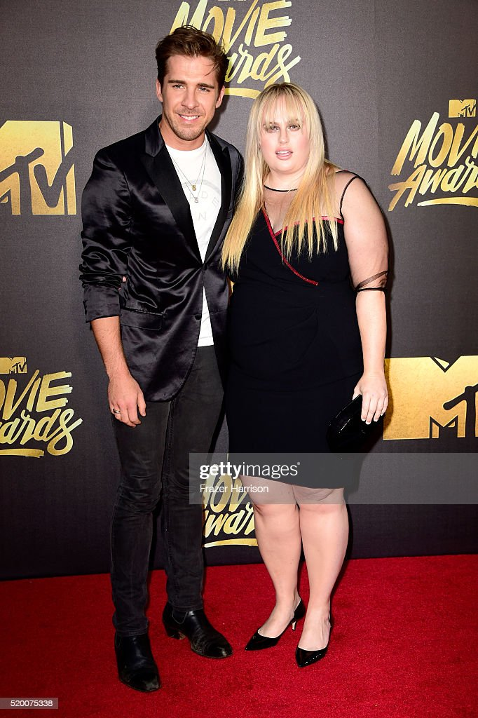 Actor Hugh Sheridan (L) and comedian Rebel Wilson attend the 2016 MTV Movie Awards at Warner Bros. Studios on April 9, 2016 in Burbank, California. MTV Movie Awards airs April 10, 2016 at 8pm ET/PT.