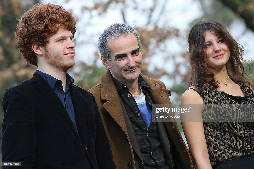 Actor Hugo Conzelmann, director Olivier Assayas and actress Carole Combes attend the 'Apres Mai' photocall at Casa del Cinema on January 14, 2013 in Rome, Italy.