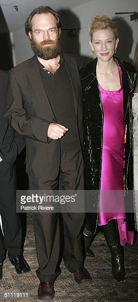 Actor Hugo Weaving and actress Cate Blanchett arrive during the opening night party for Hedda Gabler at the Sydney Theatre Company July 27 2004 in...