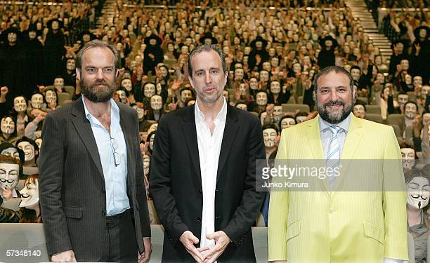 Actor Hugo Weaving director James McTeigue and producer Joel Silver stand in front of Japanese audience with masks during the Japanese premiere of 'V...