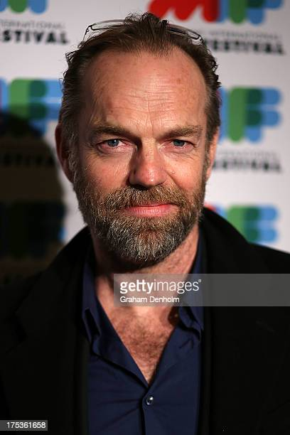Actor Hugo Weaving poses as he arrives at the world premiere of The Turning at Greater Union Cinemas on August 3 2013 in Melbourne Australia