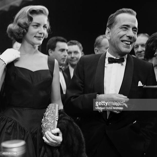 """Actor Humphrey Bogart and actress Lauren Bacall attend the premiere of """"The Desperate Hours"""" in Los Angeles, California."""