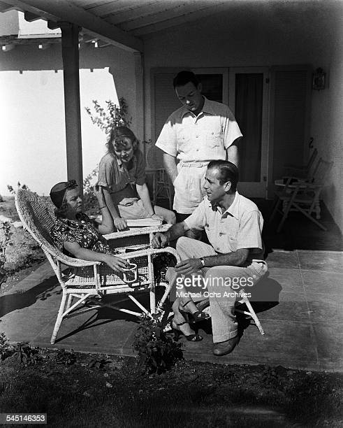 Actor Humphrey Bogart and his wife Mayo Methot visit a friend in Los Angeles California