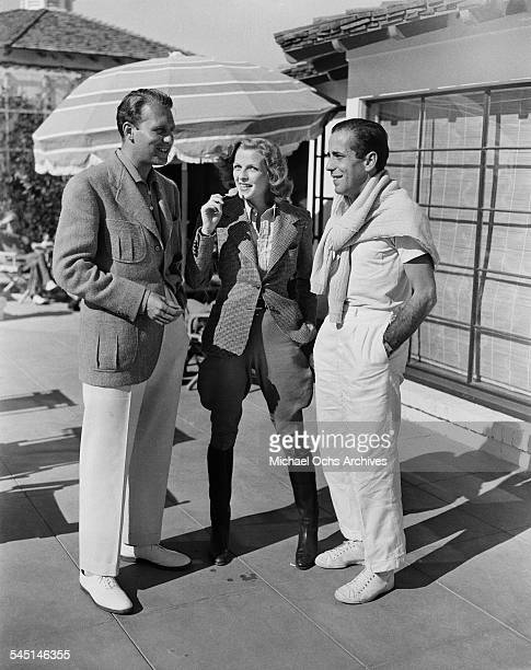 Actor Humphrey Bogart chats with actor Ralph Bellamy in Los Angeles California