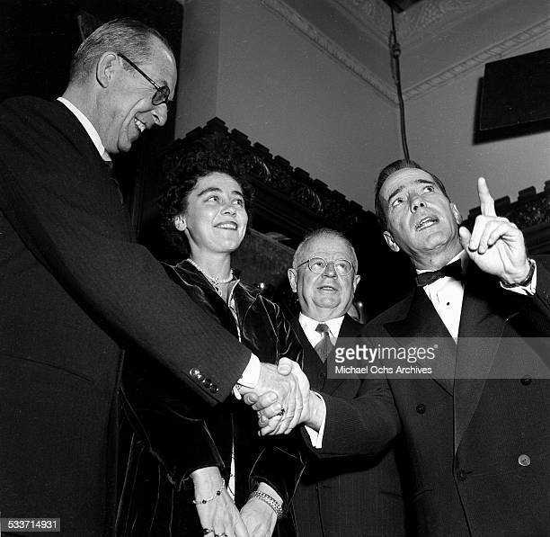 Actor Humphrey Bogart shakes hands with King Paul of Greece and Queen Frederica of Greece during a studio tour in Los Angeles,CA.