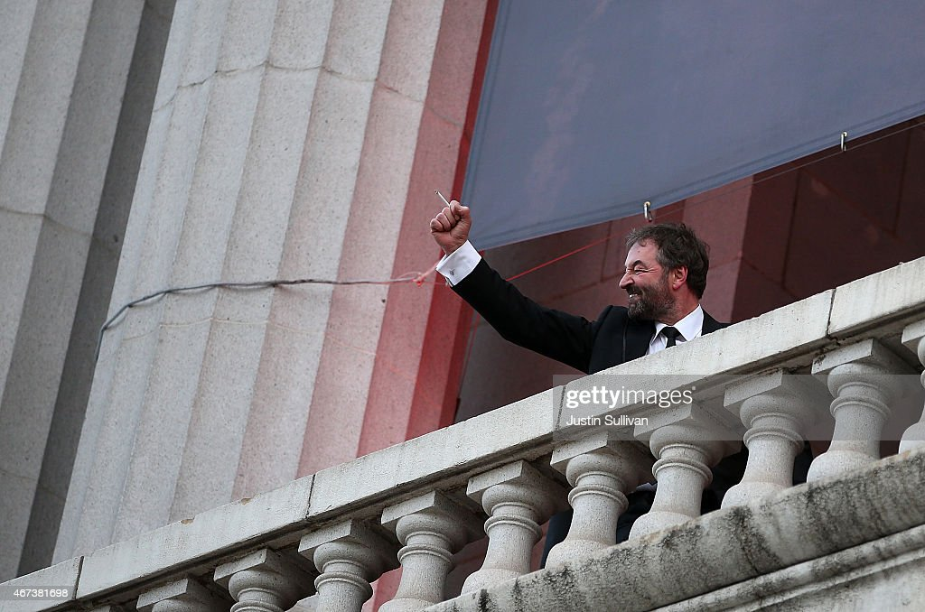 Actor Ian Beattie waves to fans from a balcony during the premiere of HBO's 'Game of Thrones' Season 5 at San Francisco Opera House on March 23, 2015 in San Francisco, California.