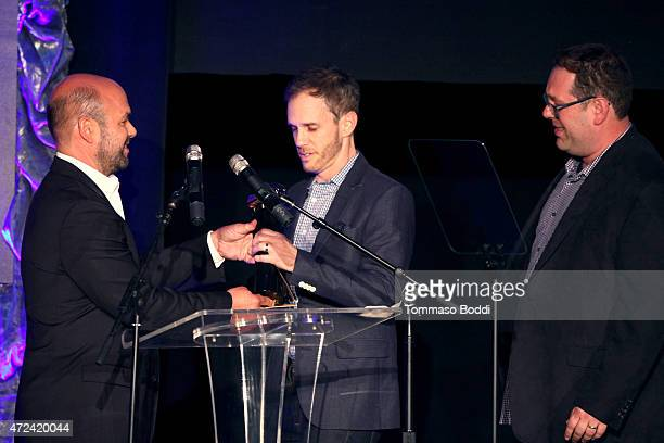 Actor Ian Gomez honors the winners of the Golden Trailer Award for Best Fantasy/Adventure Trailer creative director Dan Wolf and President of Outpost...