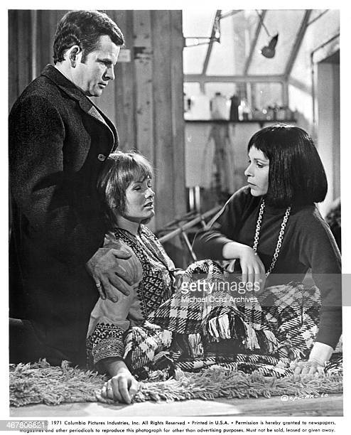 Actor Ian Holm actresses Jennie Linden and Claire Bloom on set of the movie A Severed Head circa 1970