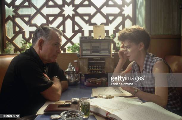 Actor Ian Holm appears with actress Judy Davis in the 1991 Canadian film Naked Lunch Directed by David Cronenberg the film is based on the William S...