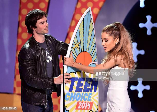 Actor Ian Somerhalder and recording artist Ariana Grande winner of Best Female Artist onstage during FOX's 2014 Teen Choice Awards at The Shrine...