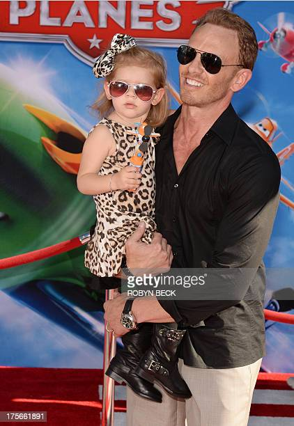 Actor Ian Ziering and daughter Mia Loren attend the premiere of Disney's Planes at the El Capitan Theatre on August 5 2013 in Hollywood California...