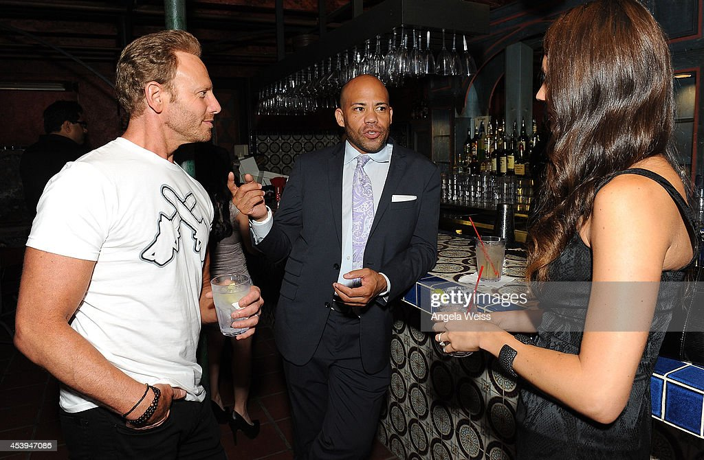 Actor Ian Ziering (L) and wife Erin with Gerald Webb (C) attend the premiere of The Asylum & Fathom Events' 'Sharknado 2: The Second One' at Regal Cinemas L.A. Live on August 21, 2014 in Los Angeles, California.