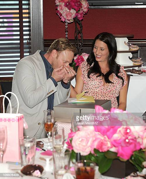 Actor Ian Ziering kisses his wife Erin Ziering's hand to celebrate their child's baby shower on March 5 2011 in Los Angeles California