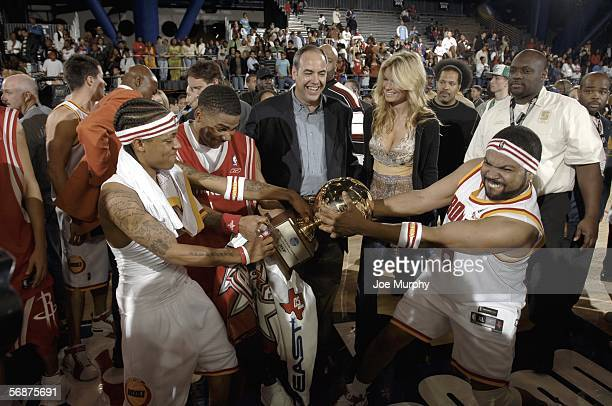 Actor Ice Cube and rapper Bow Wow of the Clutch City team try to take the MVP trophy from hiphop artist Nelly of the HTown team after the McDonald's...