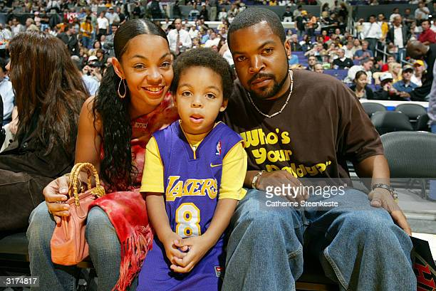 Actor Ice Cube with his wife Kimberly and son Shareef at the Los Angeles Lakers versus the New Orleans Hornets game of action on March 30 2004 at...