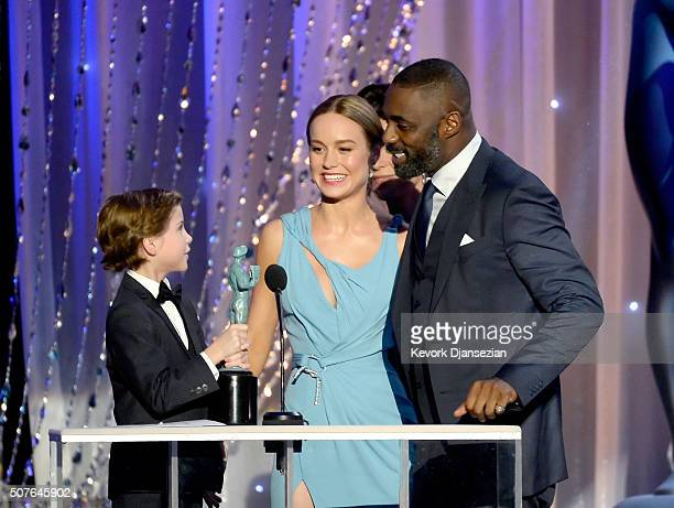 Actor Idris Elba accepts Outstanding Performance by a Male Actor in a Miniseries or Television Movie for 'Luther' from actors Jacob Tremblay and Brie...