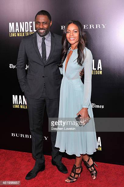 """Actor Idris Elba and actress Naomie Harris attend a screening of """"Mandela: Long Walk to Freedom"""", hosted by U2, Anna Wintour and Bob & Harvey..."""