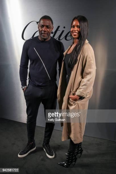 Actor Idris Elba and model Sabrina Dhowre arrive on the red carpet for the Santos de Cartier Watch Launch at Pier 48 on April 5 2018 in San Francisco...