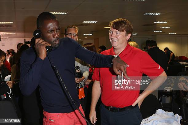 Actor Idris Elba speaks on the phone on the trading floor during the BGC Charity Day 2013 at BGC Partners on September 11 2013 in London England