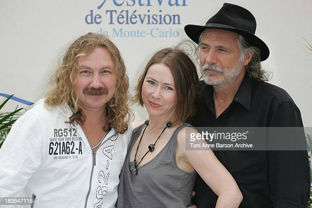Actor Igor Nikolaev actress Agata Gotova and actor Rade Serbedzija attend a photocall promoting the television series 'Say It In Russian' on the...