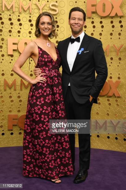 US actor Ike Barinholtz and wife Erica Hanson arrive for the 71st Emmy Awards at the Microsoft Theatre in Los Angeles on September 22 2019