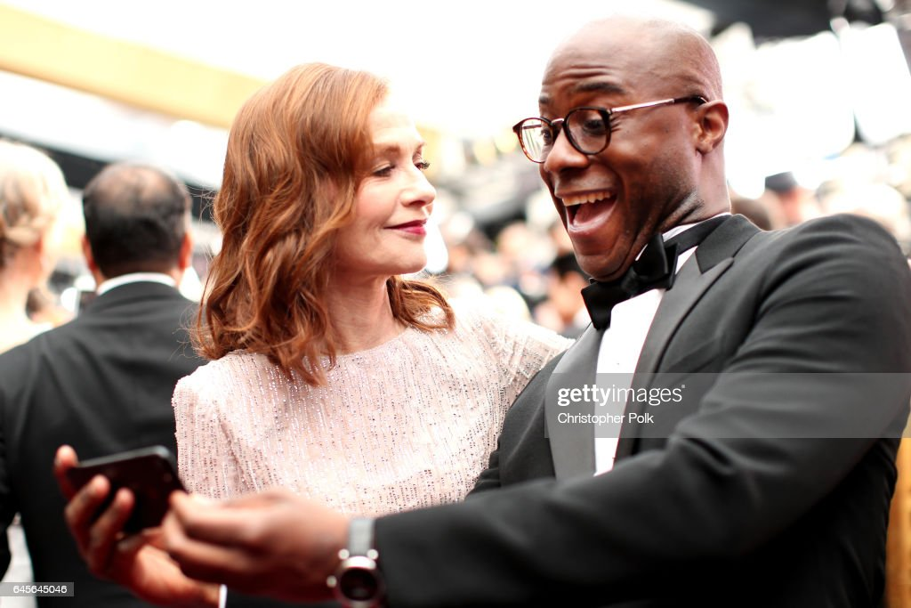 Actor Isabelle Huppert (L) and writer/director Barry Jenkins attend the 89th Annual Academy Awards at Hollywood & Highland Center on February 26, 2017 in Hollywood, California.
