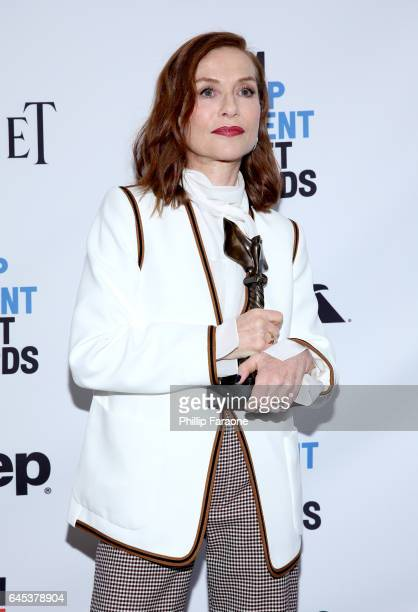Actor Isabelle Huppert winner of the Best Female Lead award for 'Elle' poses in the press room during the 2017 Film Independent Spirit Awards at the...