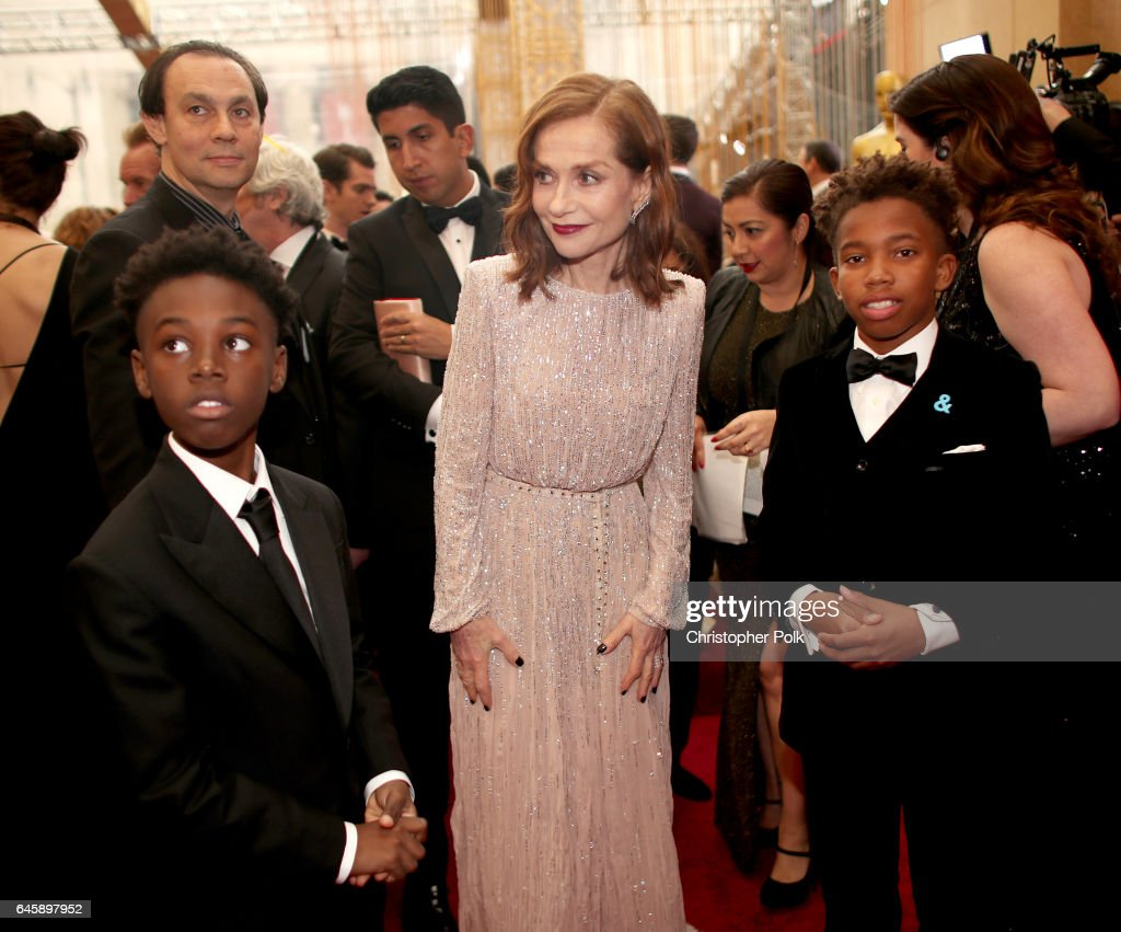 Actor Isabelle Huppert (C) with actors Alex R. Hibbert (L) and Jaden Piner (R) attend the 89th Annual Academy Awards at Hollywood & Highland Center on February 26, 2017 in Hollywood, California.