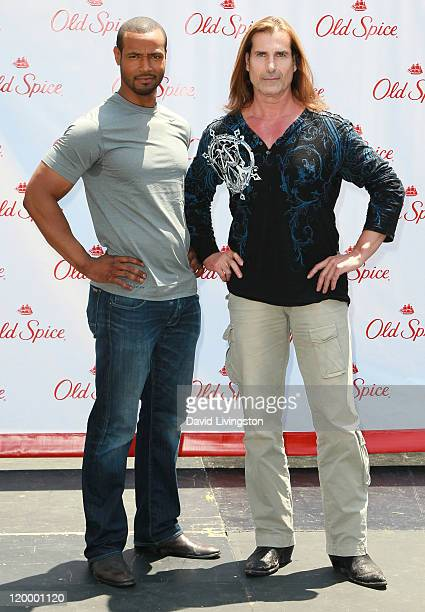 Actor Isaiah Mustafa and model Fabio pose at Old Spice's Manly Man event at The Grove on July 28 2011 in Los Angeles California