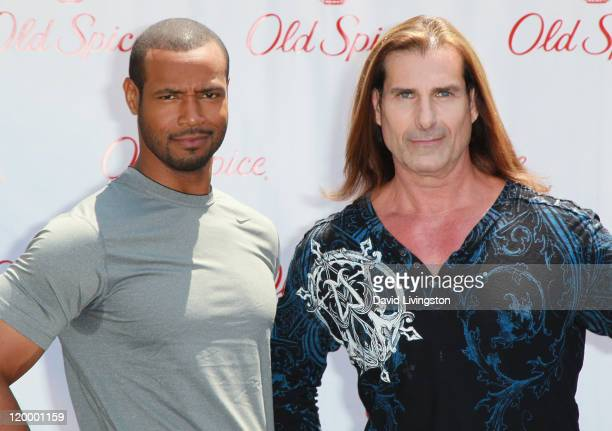 Actor Isaiah Mustafa and model Fabio pose at Old Spice's 'Manly Man' event at The Grove on July 28 2011 in Los Angeles California