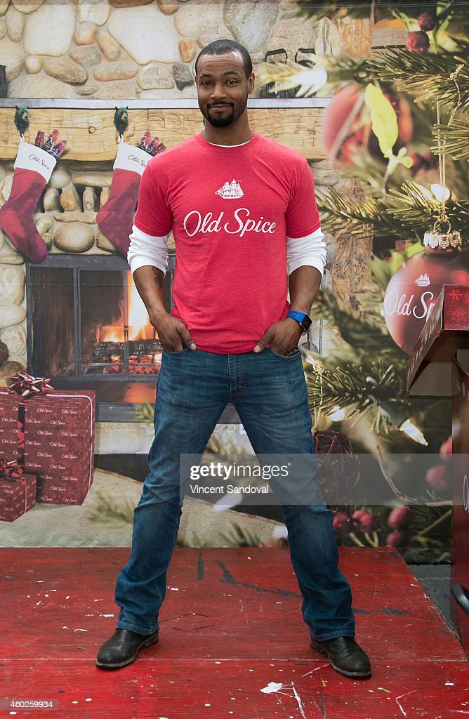 Actor Isaiah Mustafa attends the Inaugural Old Spice Holispray Holiday Toy Donation and Exchange Benefit for Second Chance Toys at Hollywood High School on December 10, 2014 in Los Angeles, California.
