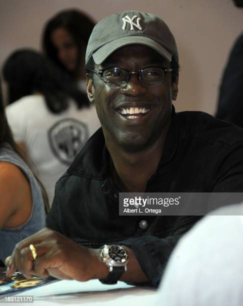 Actor Isaiah Washington signs autographs at the Warner Bros booth promoting 'The 100' on Day 2 of the 2013 ComicCon International General Atmosphere...