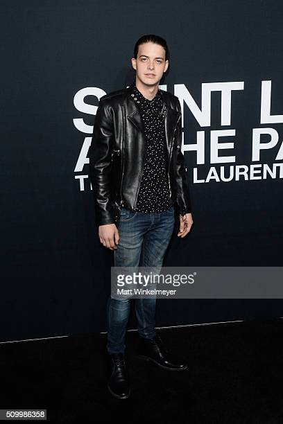 Actor Israel Broussard arrives at the Saint Laurent show at the Hollywood Palladium on February 10 2016 in Los Angeles California