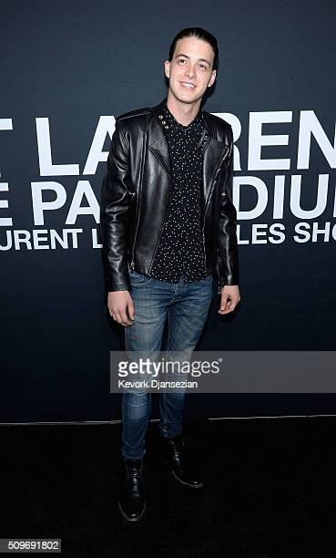 Actor Israel Broussard attends the Saint Laurent show at The Hollywood Palladium on February 10 2016 in Los Angeles California