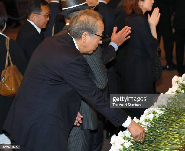 Actor Ittoku Kishibe offers a flower at an altar at the farewell meeting for late musician Hiroshi Kamayatsu on May 2, 2017 in Tokyo, Japan.