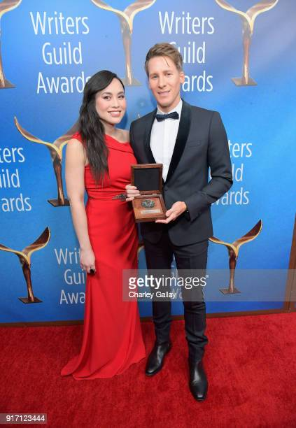 Actor Ivory Aquino and honoree Dustin Lance Black recipient of the 2018 Valentine Davies Award pose during the 2018 Writers Guild Awards LA Ceremony...