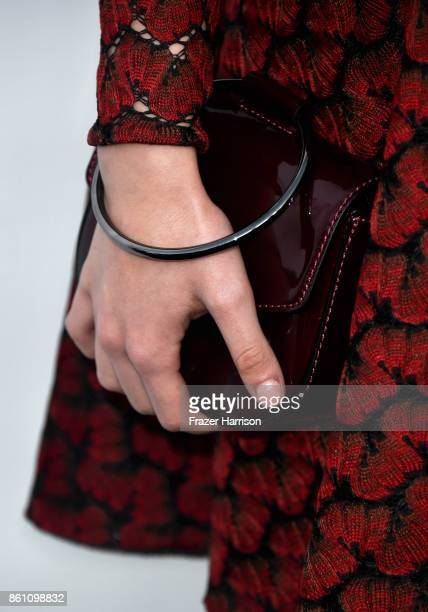 Actor Izabela Vidovic purse detail attends the amfAR Gala at Ron Burkle's Green Acres Estate on October 13 2017 in Beverly Hills California