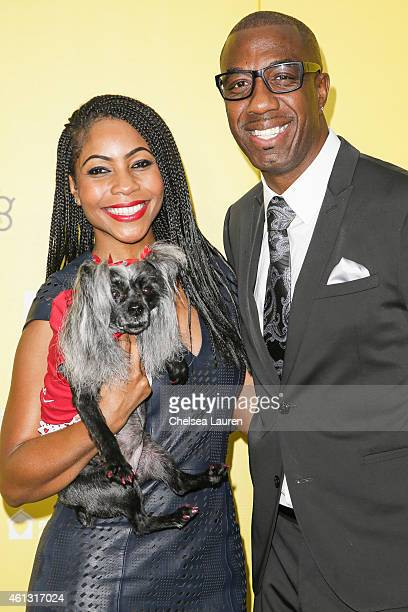 Actor J B Smoove and wife Shahidah Omar and dog Lovely arrive at The World Dog Awards at Barker Hangar on January 10 2015 in Santa Monica California