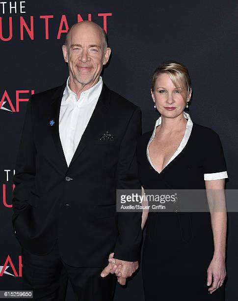 Actor J K Simmons and wife Michelle Schumacher arrive at the premiere of Warner Bros Pictures' 'The Accountant' at TCL Chinese Theatre on October 10...