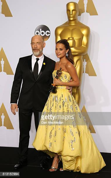 Actor J K Simmons left and actress Alicia Vikander winner of the Best Actress In A Supporting Role award for 'The Danish Girl' pose in the press room...