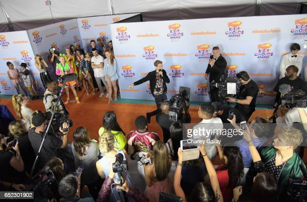 Actor Jace Norman and Host John Cena at Nickelodeon's 2017 Kids' Choice Awards at USC Galen Center on March 11 2017 in Los Angeles California