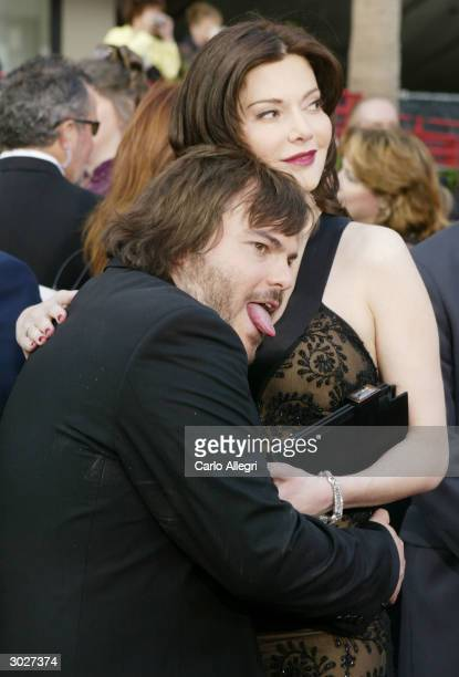 Actor Jack Black and his girlfriend Laura Kightlinger attend the 76th Annual Academy Awards at the Kodak Theater on February 29 2004 in Hollywood...