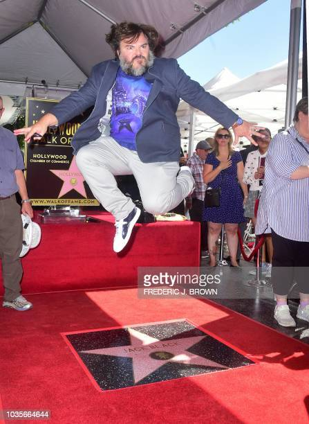 Actor Jack Black jumps over his Hollywood Walk of Fame Star during a ceremony on September 18 2018 in Hollywood California