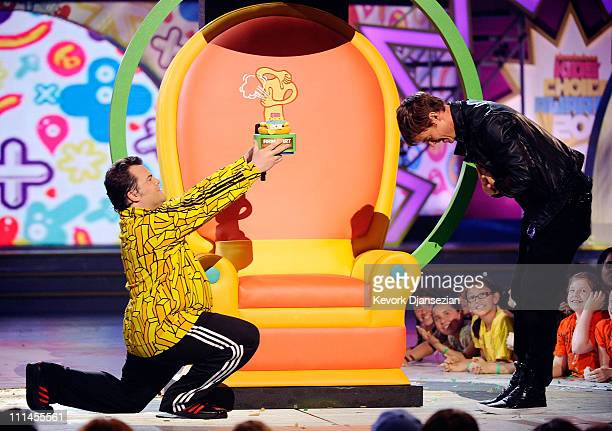 Actor Jack Black presents an award to Josh Duhamel onstage during Nickelodeon's 24th Annual Kids' Choice Awards at Galen Center on April 2 2011 in...