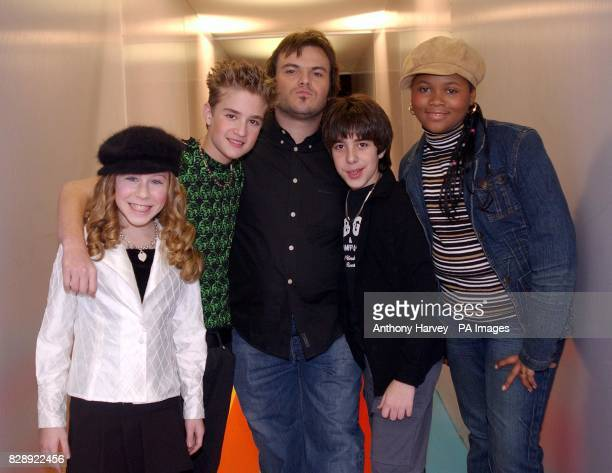 Actor Jack Black with young actors from his latest film School of Rock during his appearance on MTV's TRL UK at the MTV Studios in Camden north London