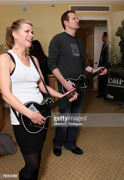 Actor Jack Coleman and wife Beth Toussaint are seen playing Guitar Hero III Legends of Rock at The Luxury Lounge in honor of the 2008 SAG Awards...